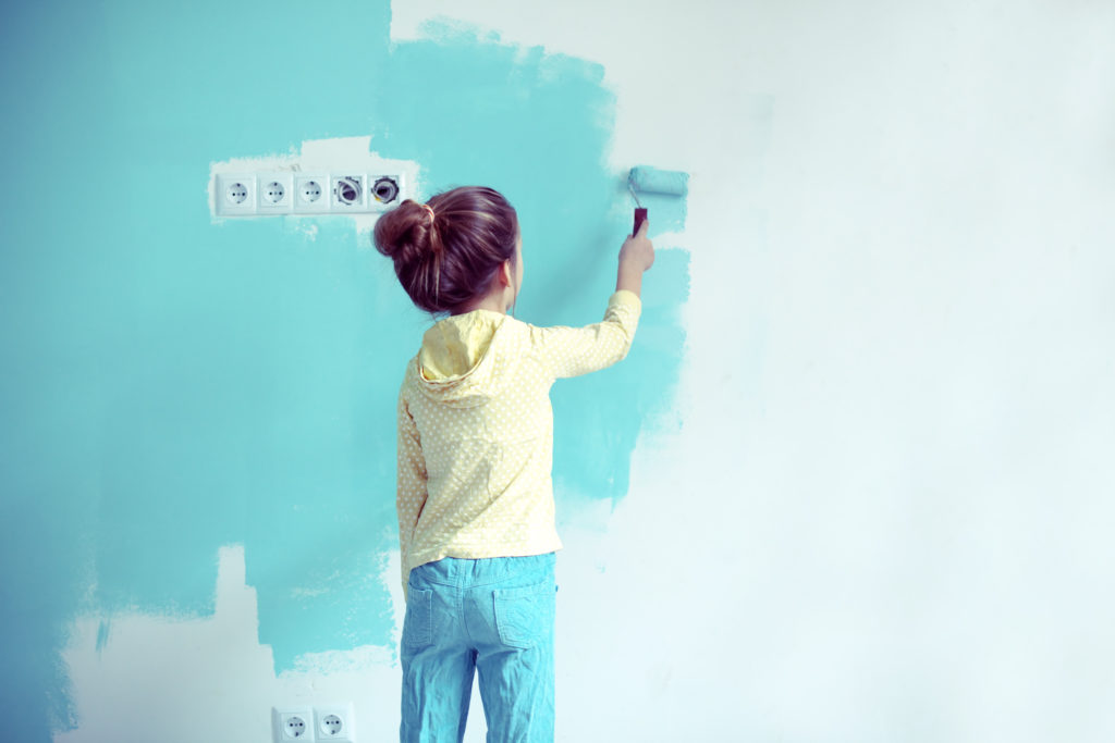 7 years old girl painting the wall at home, Instagram style toni
