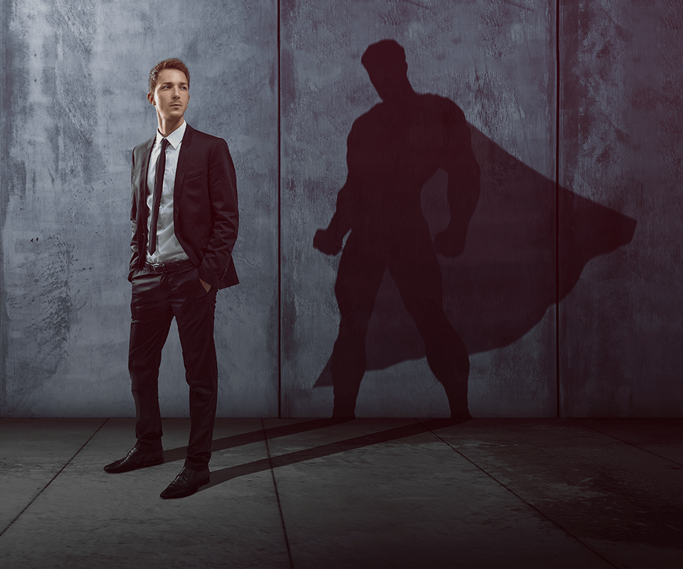 Man standing in front of a super hero shadow